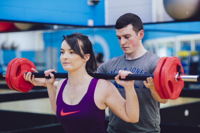 Conor Helping Client With Exercise
